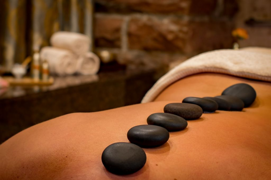hot stones on a lady's back